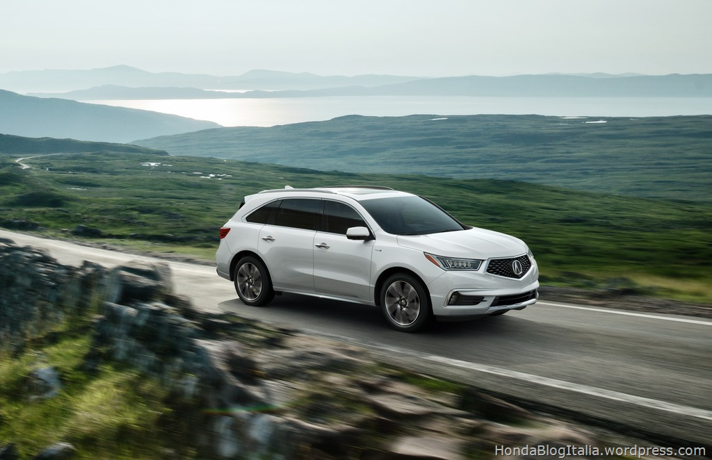 2017 MDX Sports Hybrid SH-AWD with Advance Package White Diamond Pearl Passenger front 3/4 running shot